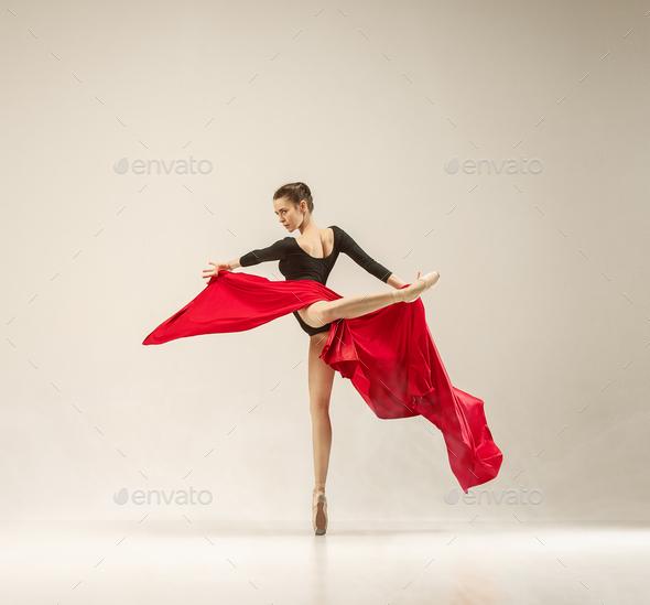Modern ballet dancer dancing in full body on white studio background. - Stock Photo - Images