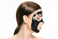 Young beautiful woman applying a mask for the face of the therapeutic black mud. Spa treatment - PhotoDune Item for Sale