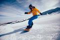 Snowboarder descent on alpine mountain slope - PhotoDune Item for Sale