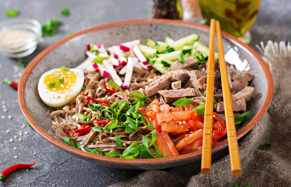 Buckwheat noodles  with beef, eggs and vegetables. Korean food.  Buckwheat pasta soup. - Stock Photo - Images