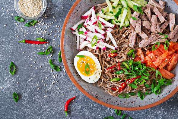 Buckwheat noodles  with beef, eggs and vegetables. Korean food. - Stock Photo - Images