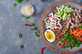 Buckwheat noodles  with beef, eggs and vegetables. Korean food. - PhotoDune Item for Sale