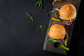 Big sandwich - hamburger burger with beef,  tomato, basil cheese and arugula. Top view. Flat lay - PhotoDune Item for Sale