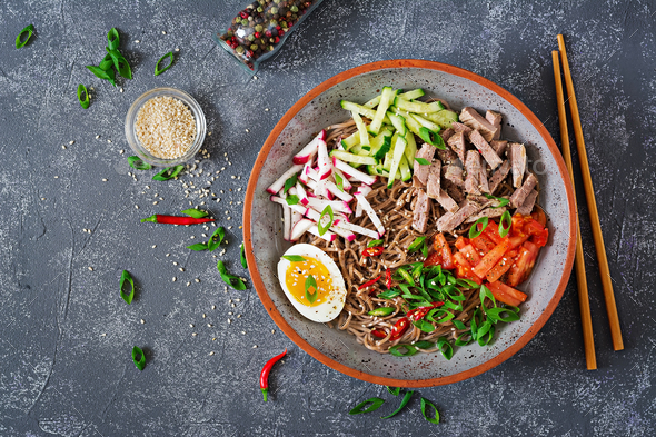 Buckwheat noodles  with beef, eggs and vegetables. Korean food - Stock Photo - Images