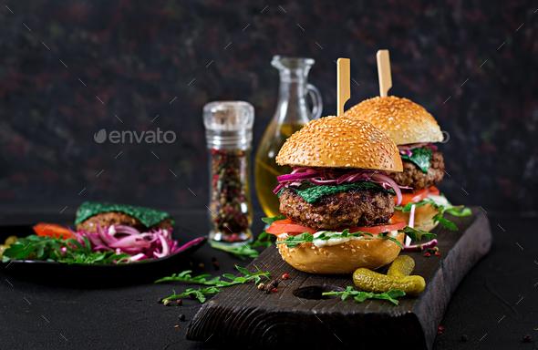 Big sandwich - hamburger burger with beef,  tomato, basil cheese and arugula. - Stock Photo - Images