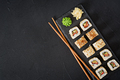 Traditional Japanese food - sushi, rolls and chopsticks for sushi on a dark background. Top view - PhotoDune Item for Sale
