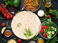 Ingredients for burritos wraps with beef and vegetables on black background. - PhotoDune Item for Sale