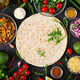 Ingredients for burritos wraps with beef and vegetables on black background - PhotoDune Item for Sale