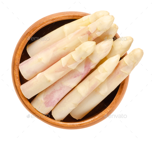 Raw white asparagus tips in wooden bowl - Stock Photo - Images