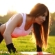 Push ups or Press ups Exercise by Young Woman on Grass - VideoHive Item for Sale