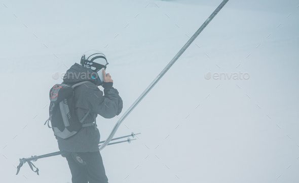 Speaking on the phone at ski lift - Stock Photo - Images