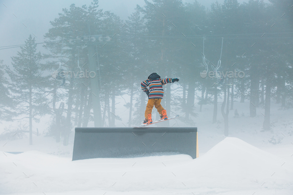Skier doing snowboarding jumping a ramp - Stock Photo - Images
