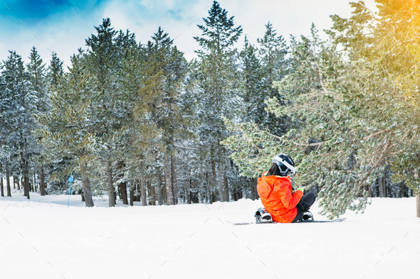 Snowboarder uses the mobile phone at the ski resort - Stock Photo - Images