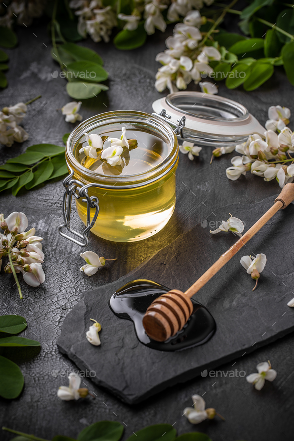 Honey in jar with honey dipper - Stock Photo - Images
