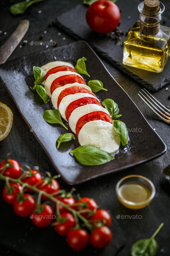 Traditional italian tomato salad caprese - Stock Photo - Images