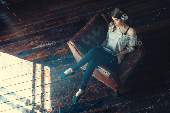 Young girl listen to music - Stock Photo - Images