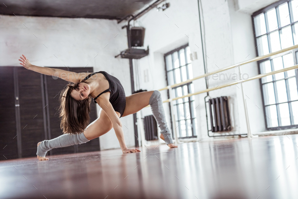 Dancing girl in the loft - Stock Photo - Images