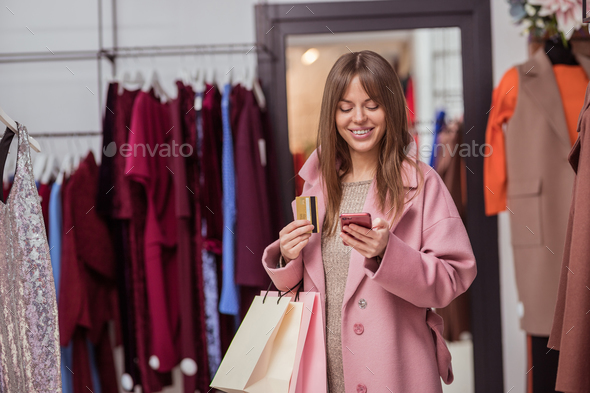 Smiling customer with a phone - Stock Photo - Images