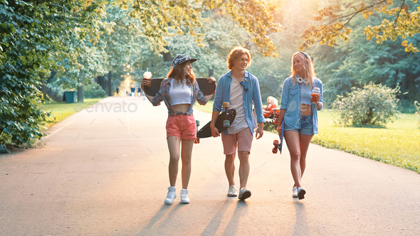 Smiling people with skateboards - Stock Photo - Images