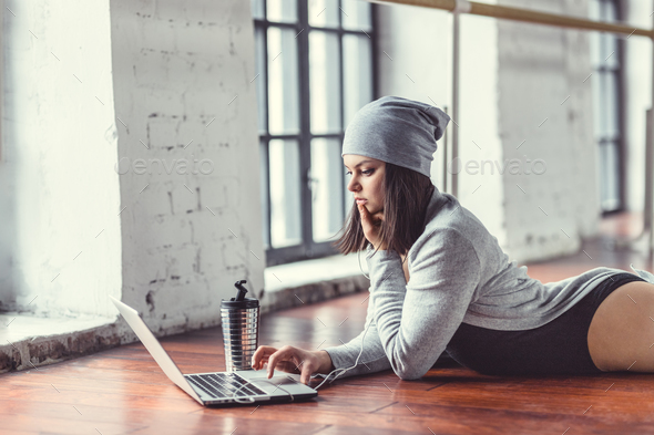 Young woman with laptop indoors - Stock Photo - Images