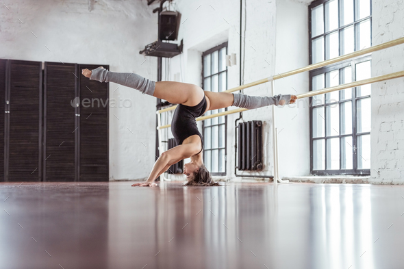 Young dancer on training in dance studio - Stock Photo - Images
