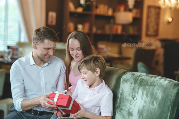 Young family at home - Stock Photo - Images