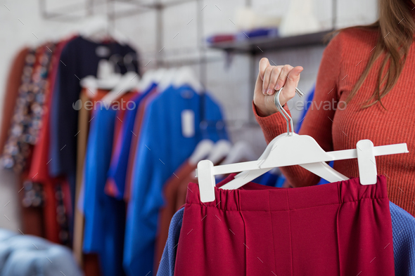 Young woman with clothes - Stock Photo - Images