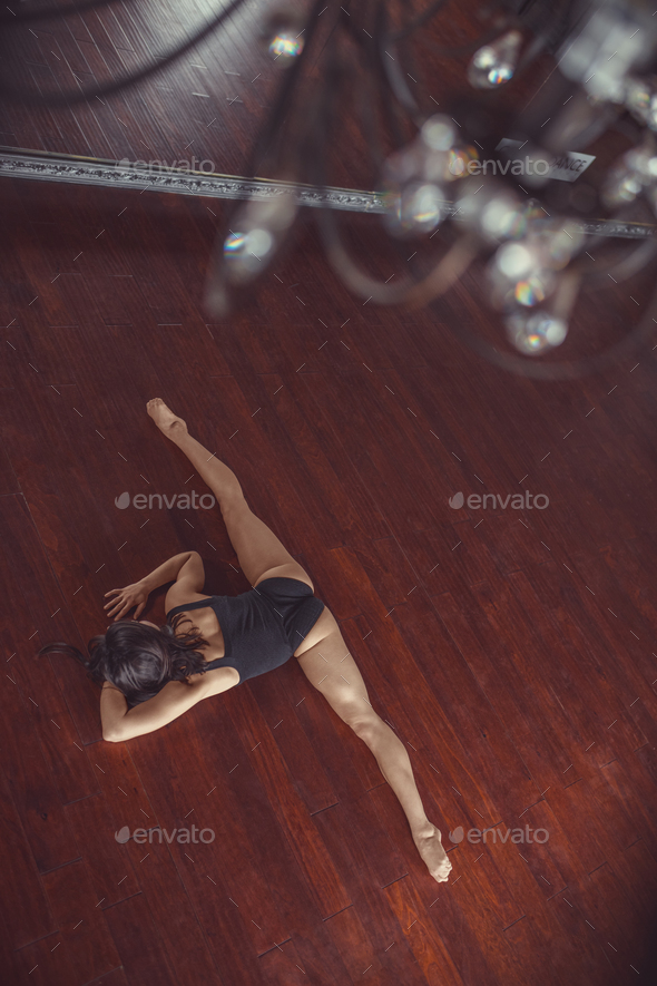 Young ballerina stretches indoors - Stock Photo - Images