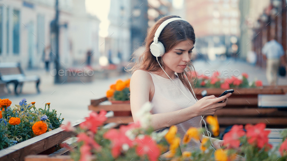 Young woman with headphones - Stock Photo - Images