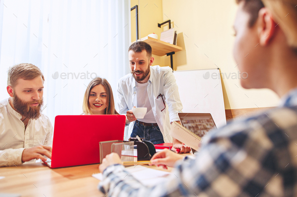 Team job. Photo young businessmans working with new project in office - Stock Photo - Images
