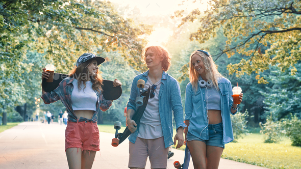 Smiling skateboarders in the park - Stock Photo - Images