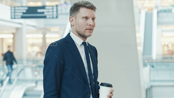 Young businessman in suit with coffee - Stock Photo - Images