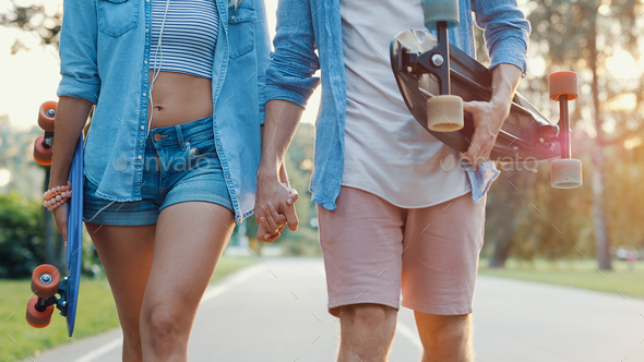 Young couple with skateboards - Stock Photo - Images