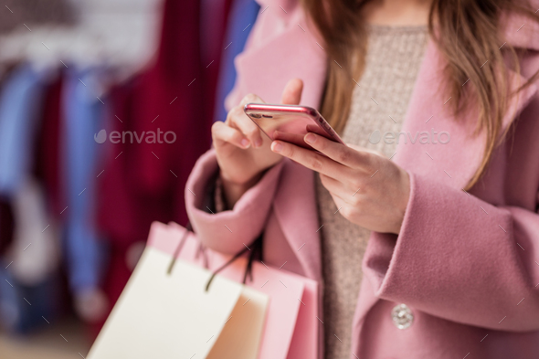 Young customer with a phone - Stock Photo - Images