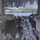 Little Waterfall under the Bridge on the Background of Lake at Winter - VideoHive Item for Sale