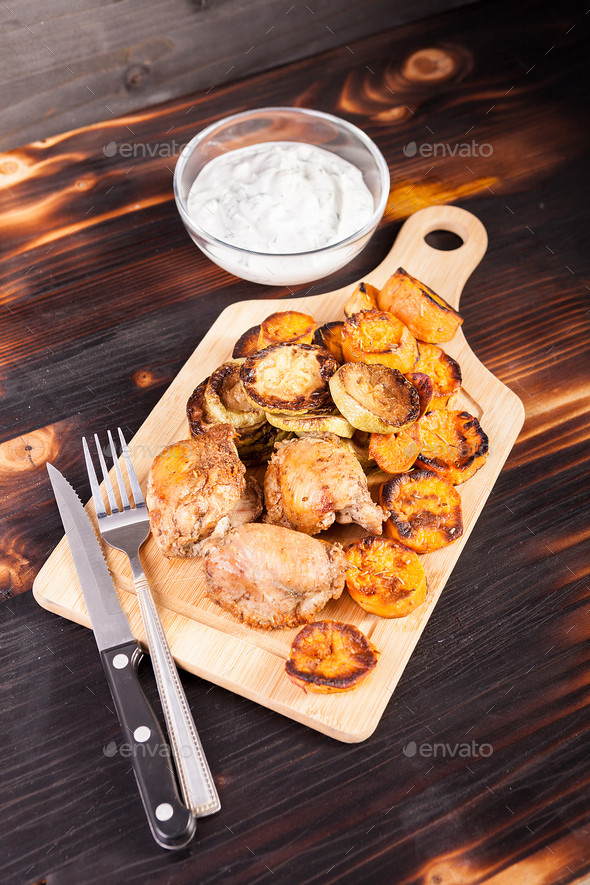 Wooden plate with fried chicken - Stock Photo - Images
