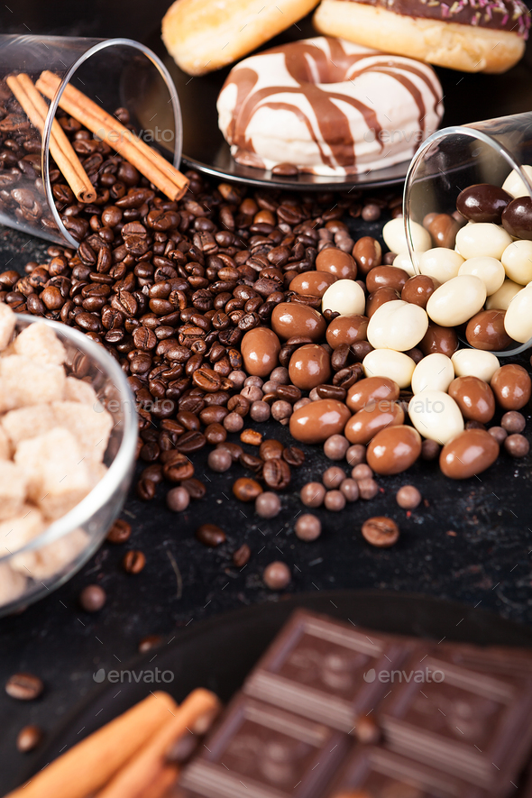 Brown sugar in a glass bowl next to candies and sweets - Stock Photo - Images