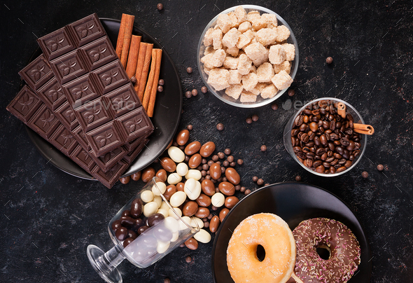 Glass with coffee beans next to chocolate tablets - Stock Photo - Images