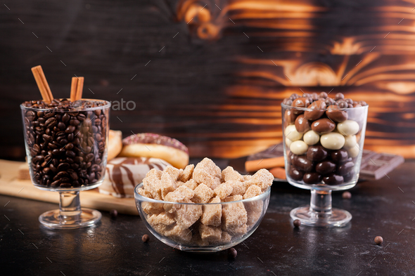 Candies, brown sugar, donuts and coffee - Stock Photo - Images