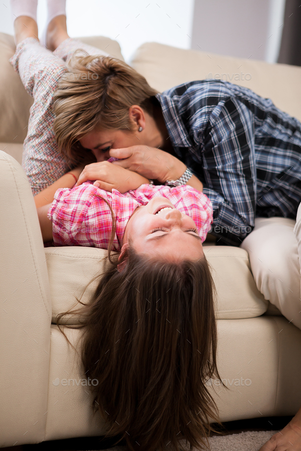 Portrait of young beautiful mother with her teenage daughter - Stock Photo - Images