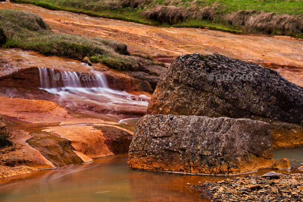 Stream And Rust Colored Rocks, Iceland - Stock Photo - Images