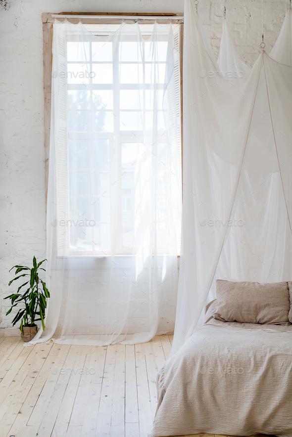 Bedroom in soft light colors with a wooden floor. - Stock Photo - Images
