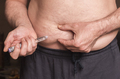 Man with diabetes will prick insulin in the belly, image conceptual - PhotoDune Item for Sale