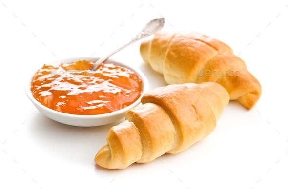 Sweet buttery croissants and fruity jam. - Stock Photo - Images