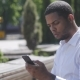 African American Man Sms Texting Using App on Smart Phone in City - VideoHive Item for Sale