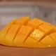 Sliced Mango Fruit. Rotating Camera with White Kitchen on the Background - VideoHive Item for Sale