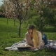 Charming Young Woman Reading a Book in Spring Park - VideoHive Item for Sale