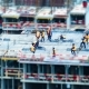 Builders and Cranes Working on the Construction Site - VideoHive Item for Sale