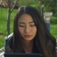 Charming Asian Girl with Tablet Pc in Spring Park - VideoHive Item for Sale