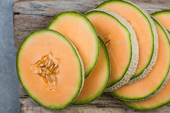 Cantaloupe melon slices on board - Stock Photo - Images